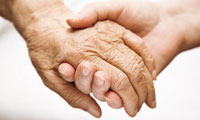 holding older person hand